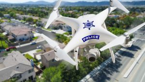 Picture of a police drone flying above a neighborhood